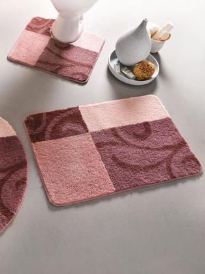 Tapis de bain motif volutes