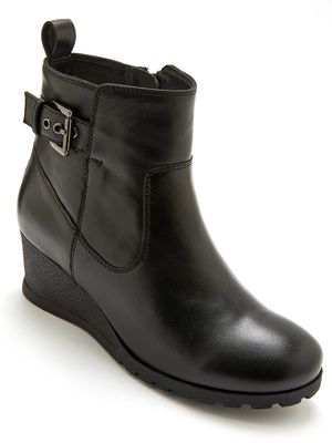 Boots zippées en cuir semelle compensée
